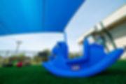 Blue Shade Sail and kid toys