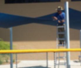 Patrick on ladder_install_baseball field