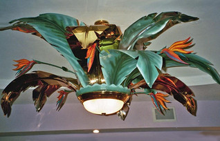 Polished brass, aluminum and painted. Fronds with painted, metal, bird of paradise.