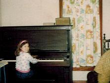 Staci at piano age 7.jpeg