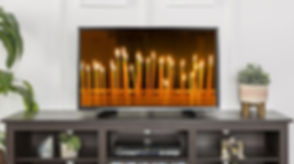 tv with candles cropped.jpg