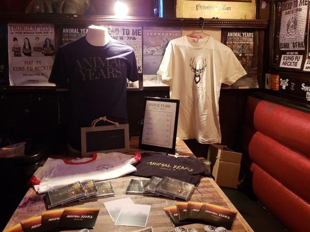 The merch table for Animal Years at Kung Fu Necktie.