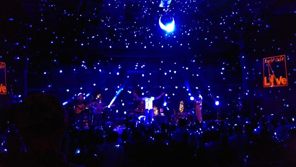 A picture of Carbon Leaf on stage with lots of blue lights.