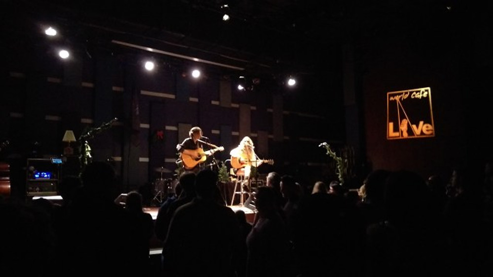 A picture of Sarah Darling with her guitarist on stage at World Cafe Live.