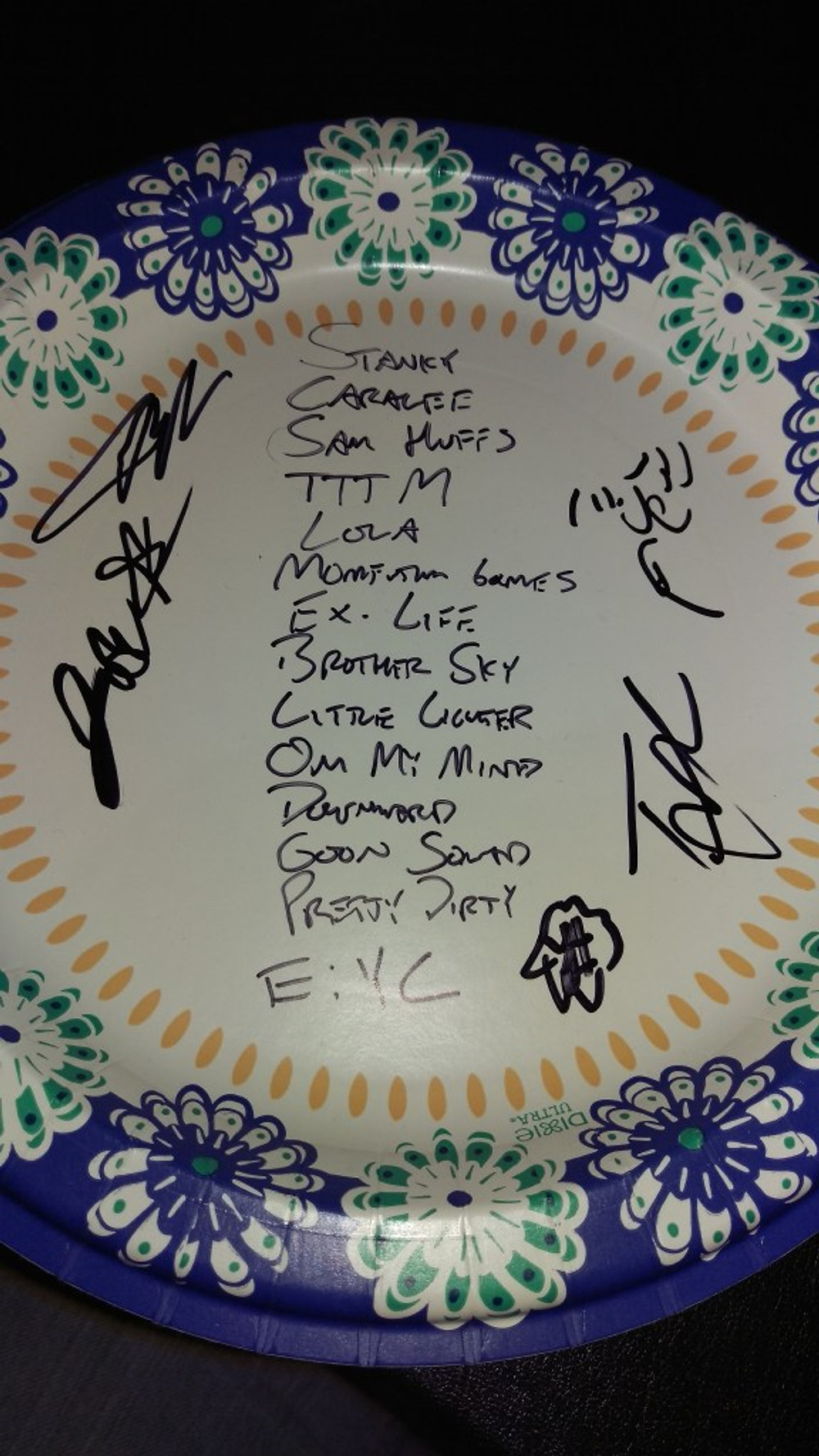 The set list written on a paper plate with the band's signatures.