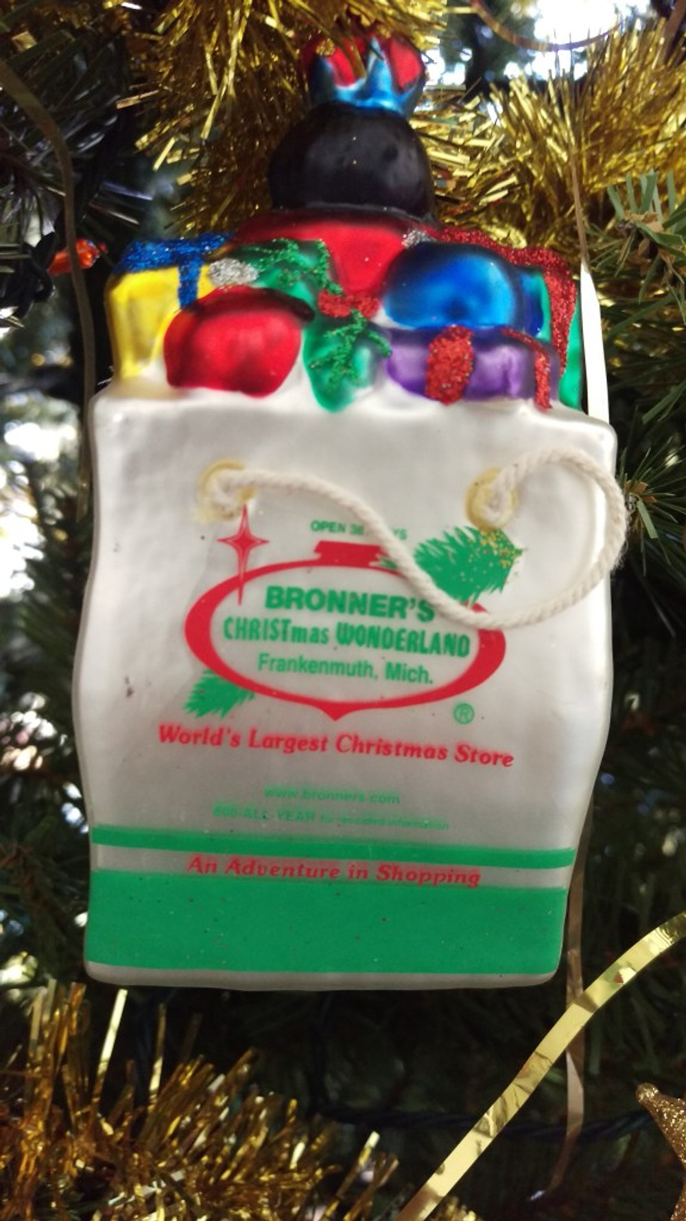 An ornament shaped like a shopping bag and filled with ornaments. It's a replica of the bags they use at Bronner's.