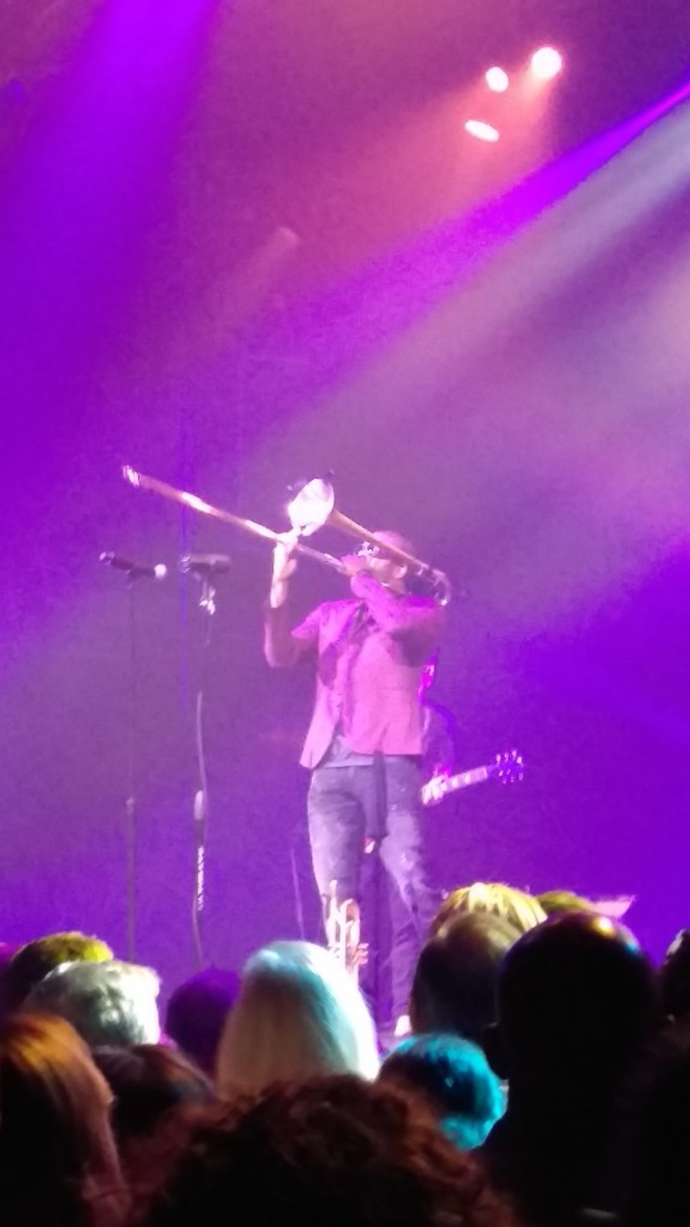 This is a picture of Troy Andrews playing the trombone during the first song of their set.