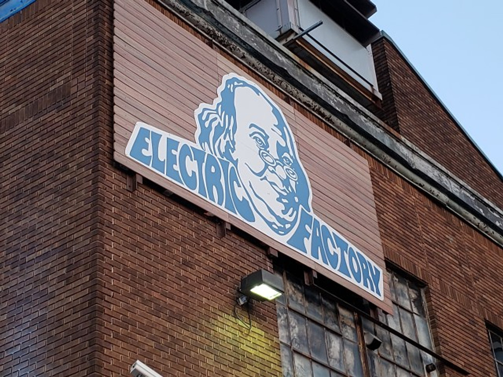 The outside sign at the Electric Factory showing Ben Franklin.
