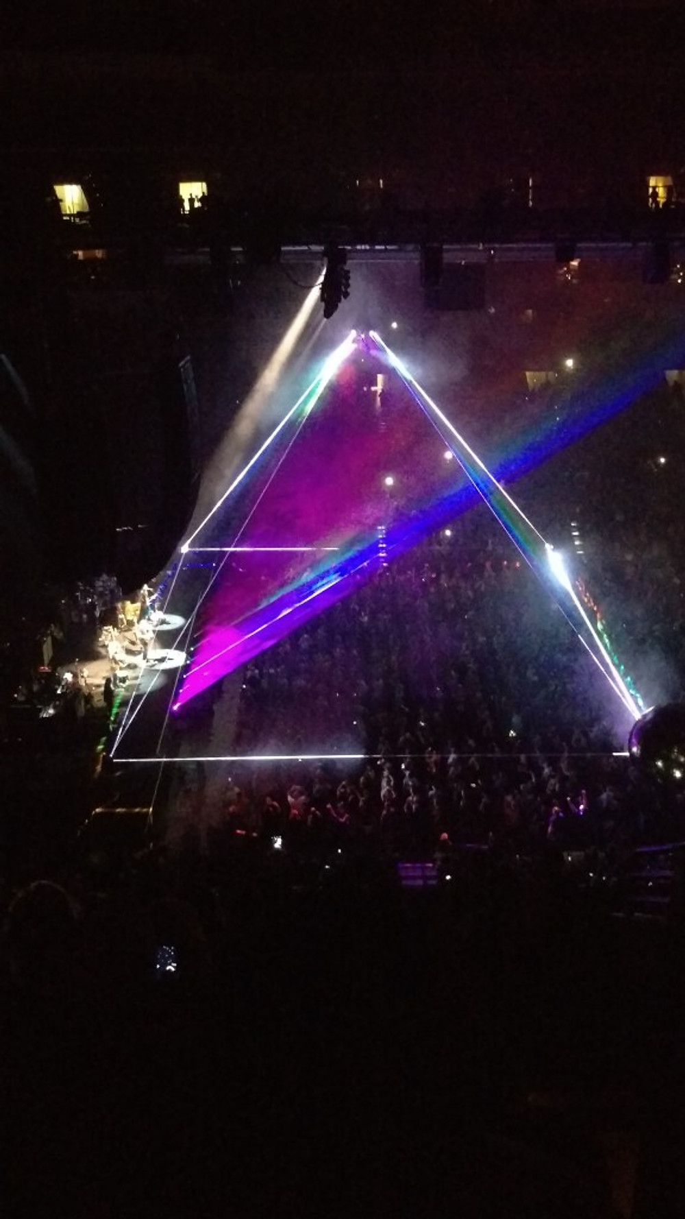 """A picture of the """"Pink Floyd pyramid"""" in lights during the Roger Waters show."""