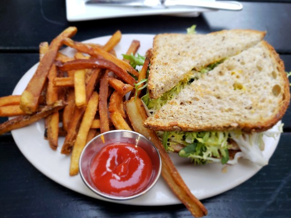 The jerk chicken sandwich and fries at Mikboy.