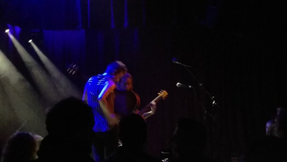 A picture of Tim Reynolds and Christie Lenee on stage together to close out the show.