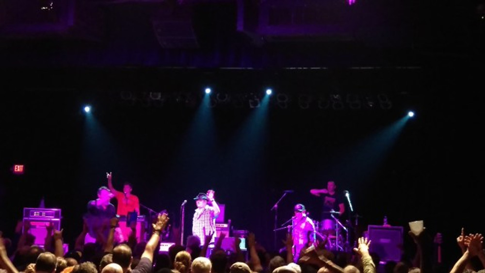 A picture of the band thanking the crowd at the end of the set.