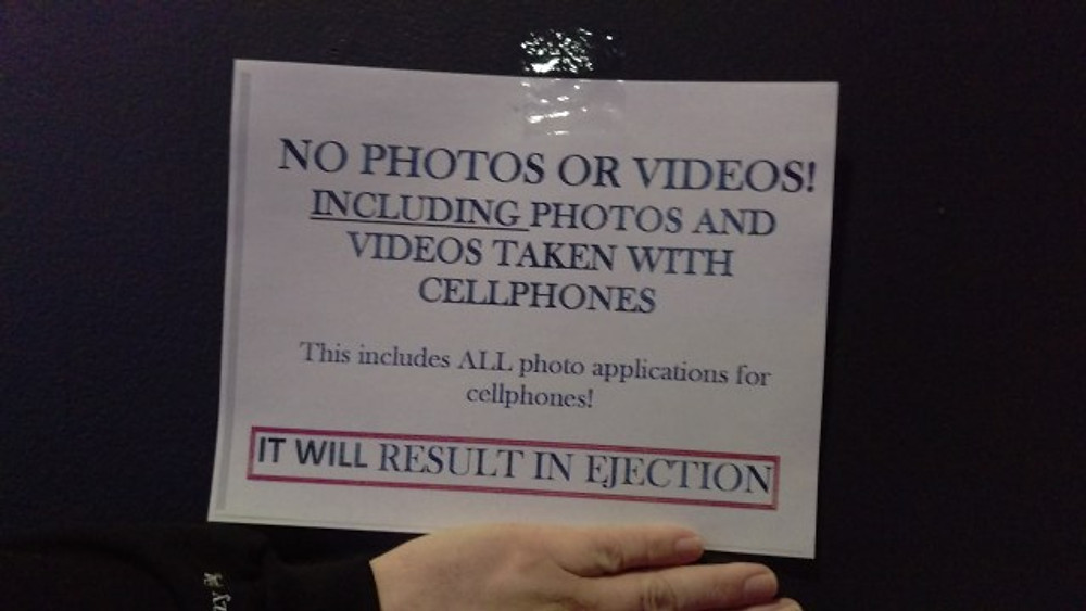 """A picture of a sign for the A Perfect Circle show that says """"No photos or videos! Including photos and videos taken with cellphones. This includes ALL photo applications for cellphones! It will result in ejection."""