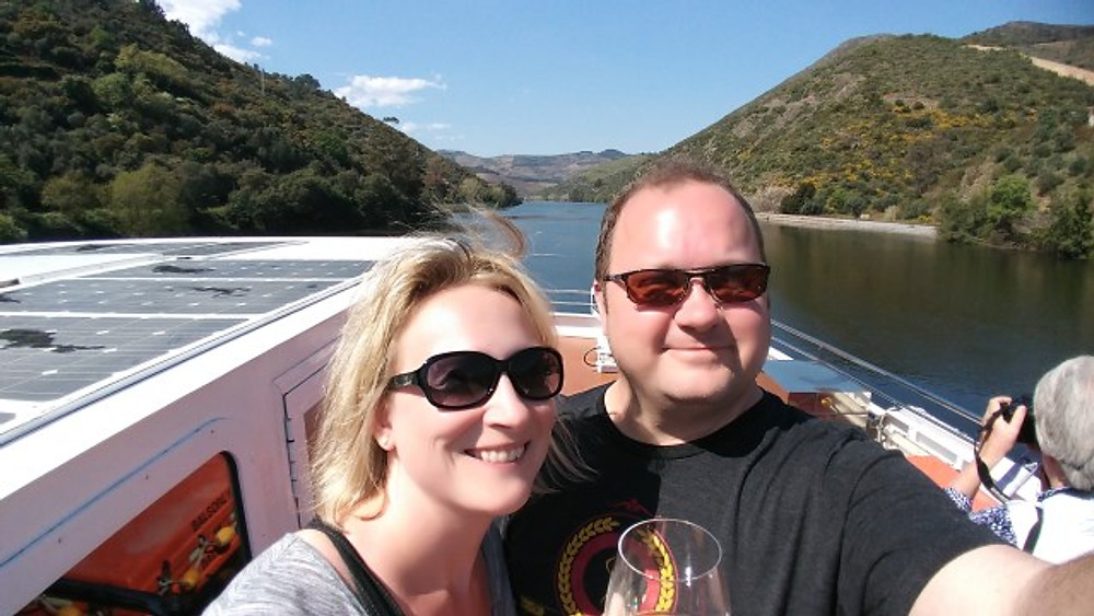 A picture of my husband and I on the Douro River in Portugal.