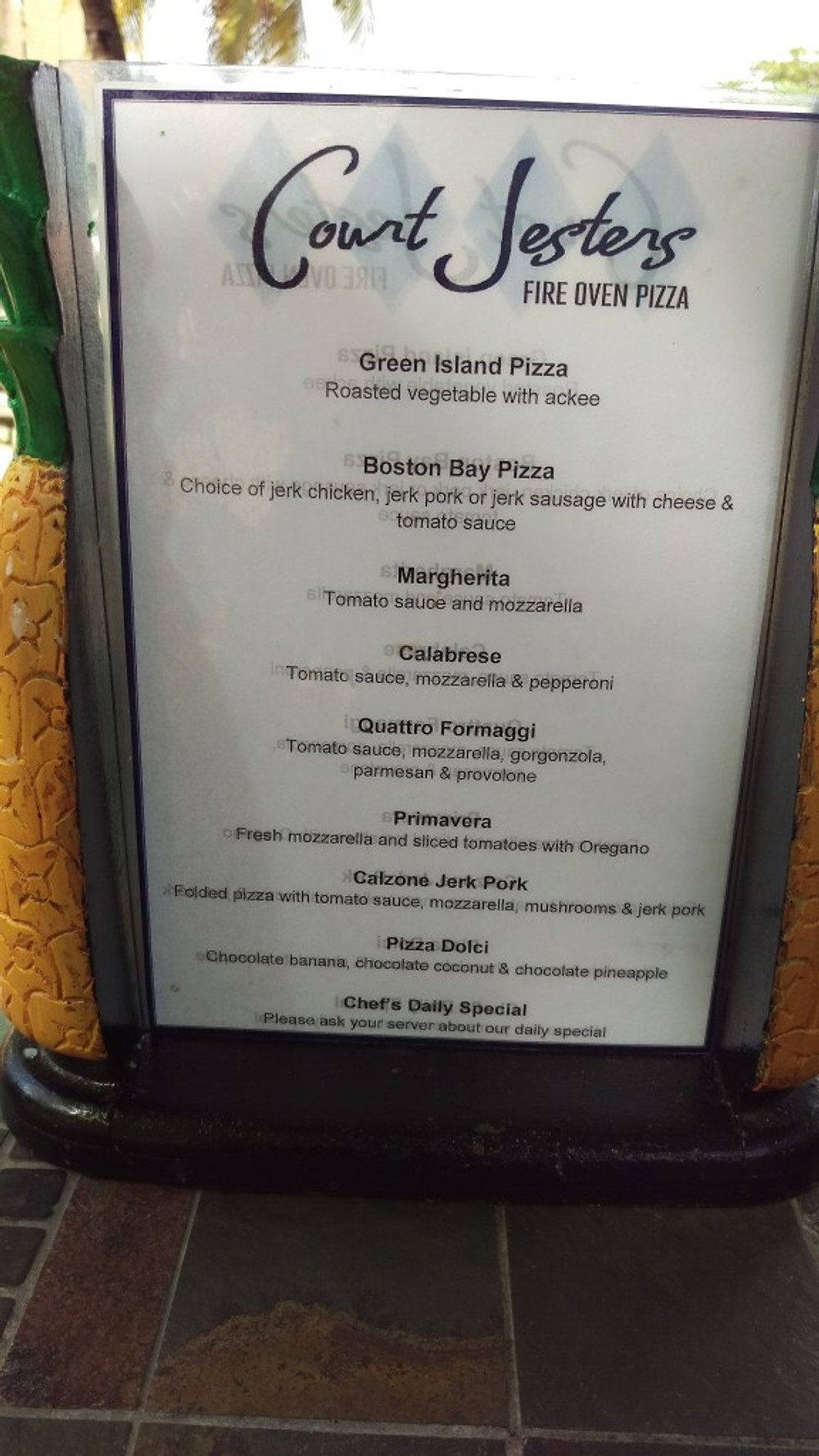 A picture of the menu at the Court Jester's pizza restaurant.