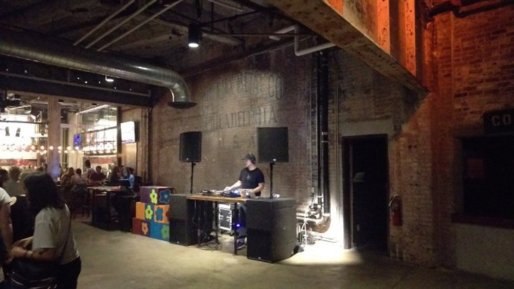 A DJ playing music in the lobby area of The Fillmore prior to the show.