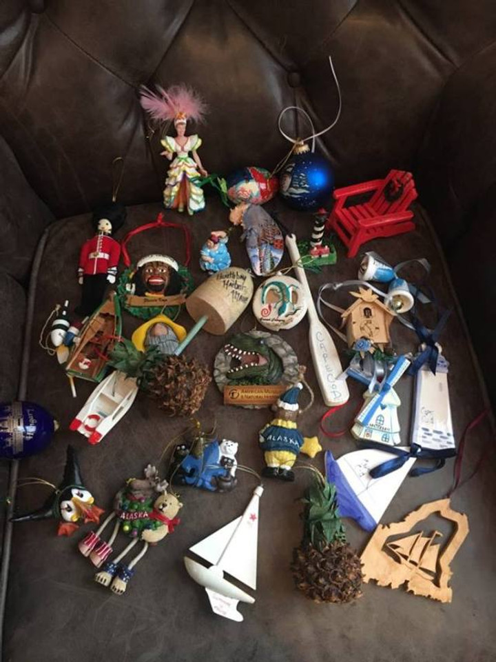 A picture of a number of ornaments from lots of different locations laying out.