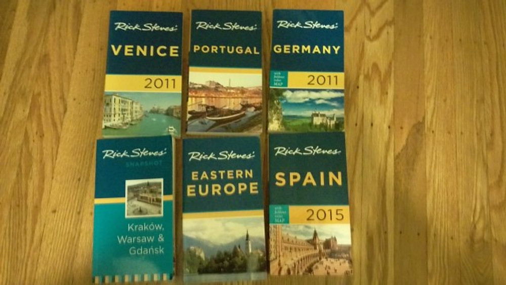 A pictures of all of my Rick Steves' books including Venice, Portugal, Germany, Spain, Eastern Europe, and Poland.