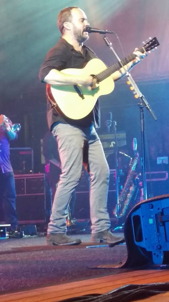 A close up of Dave Matthews on stage.