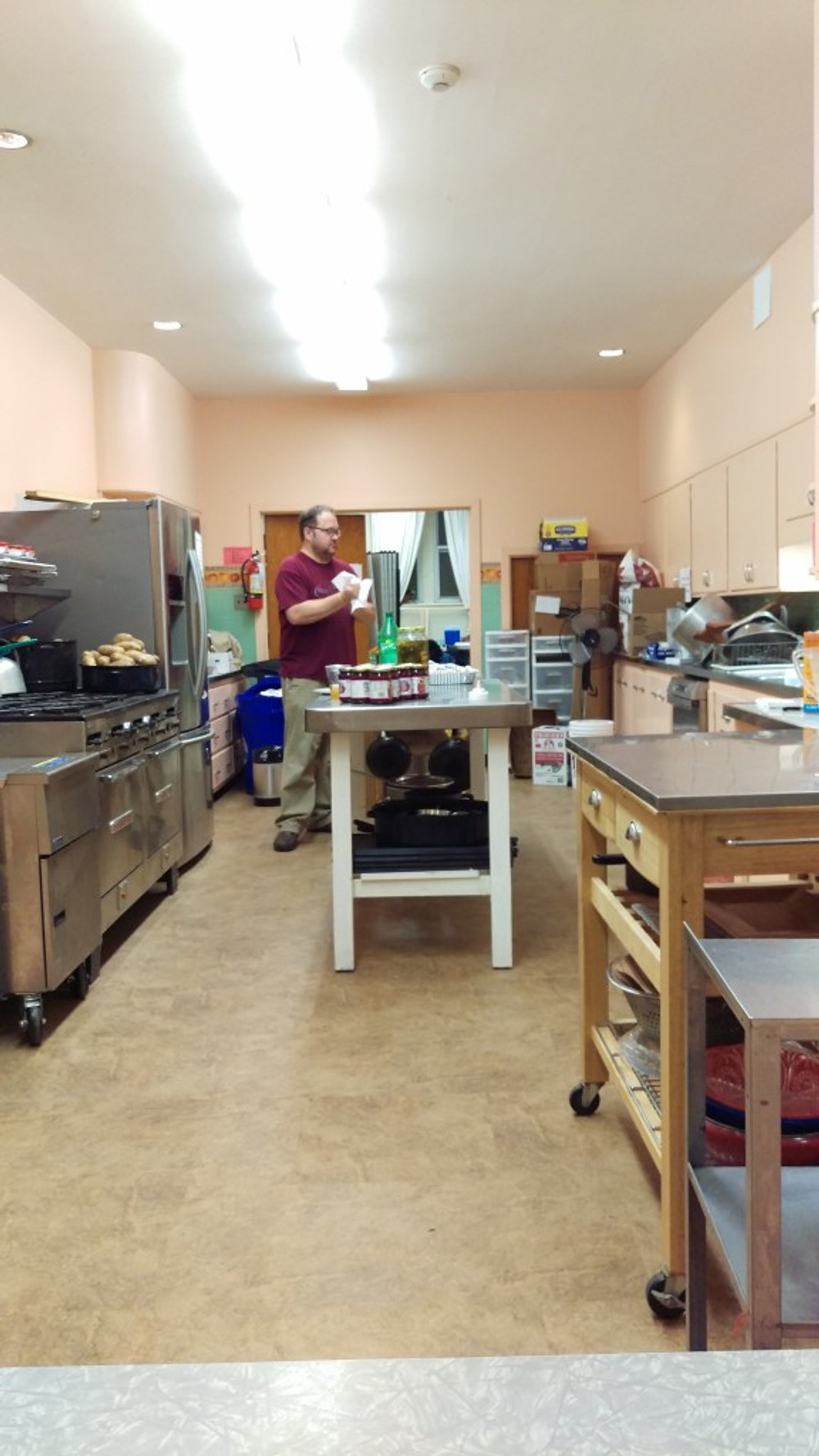 A picture of the church kitchen and my husband prepping food.