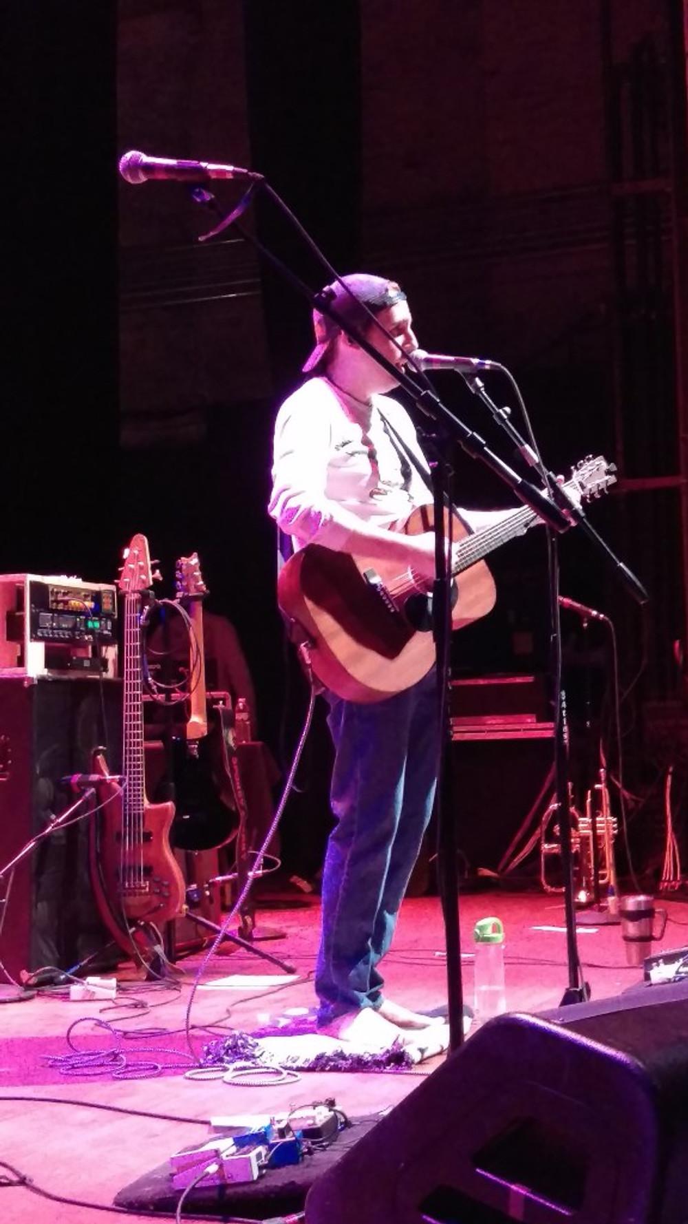 Spokey Speaky lead singer Jeff Ferrara on stage at The Queen.