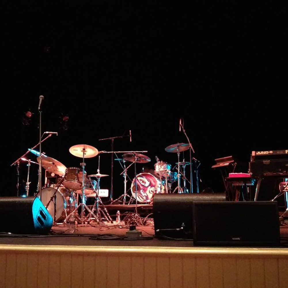 A picture of a band's set up on the stage of the theater.
