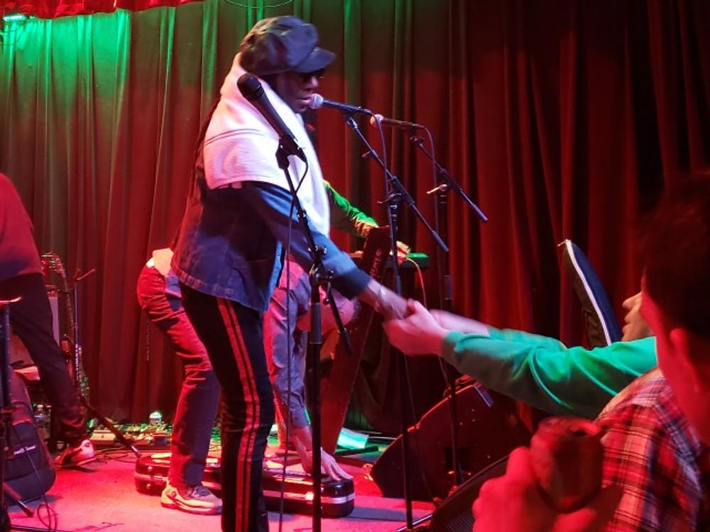 Junior Marvin shaking hands