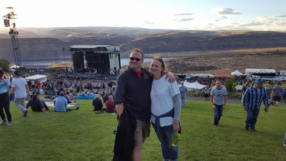 A picture of my husband and I at the top of the lawn at the Gorge.