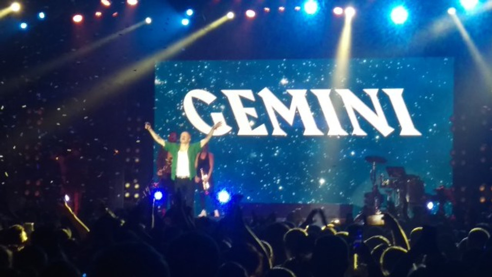 Macklemore holding his arms up in thanks to the crowd.