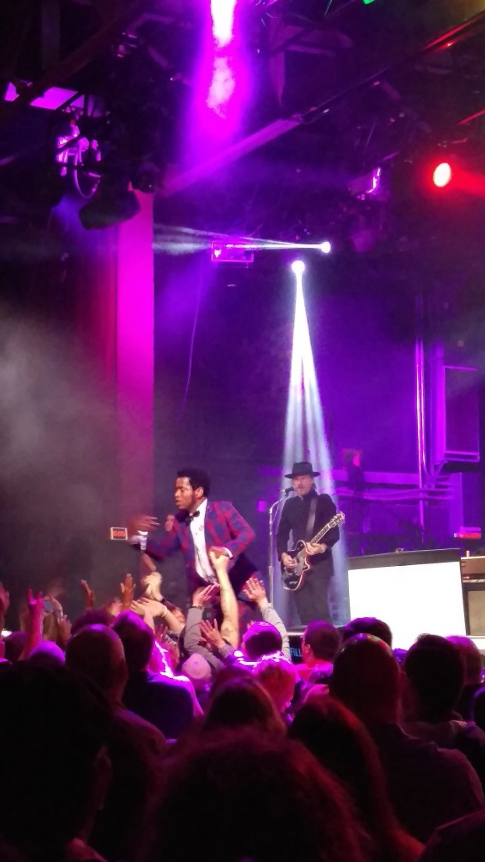 A picture of Vintage Trouble on stage.