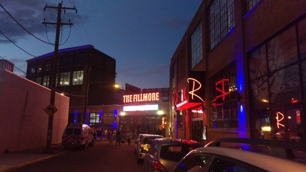 The outside of The Fillmore with the lighted sign on the front of the building.