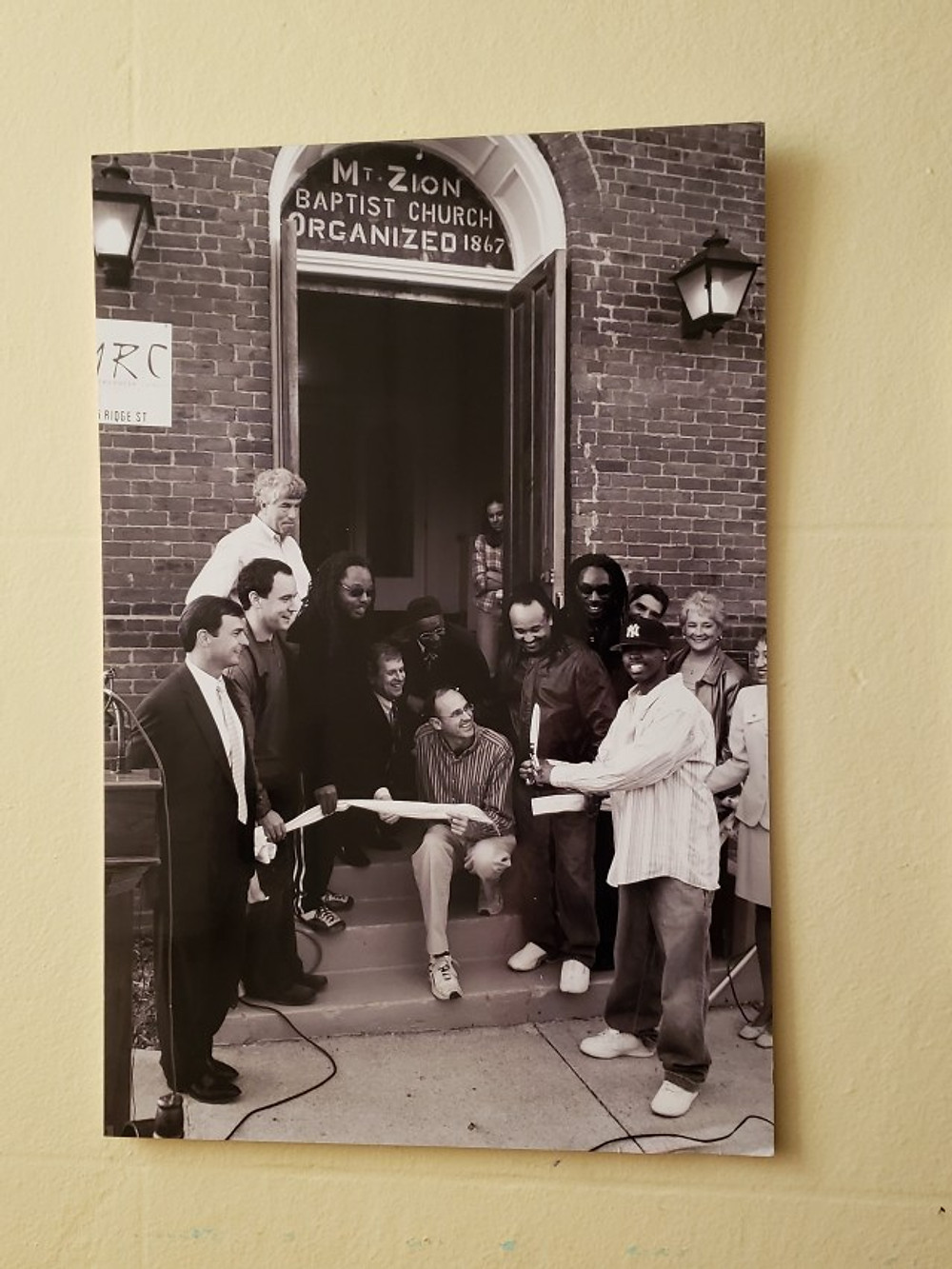 A picture of Dave Matthews Band at the ribbon cutting ceremony for the Music Resource Center in Charlottesville.