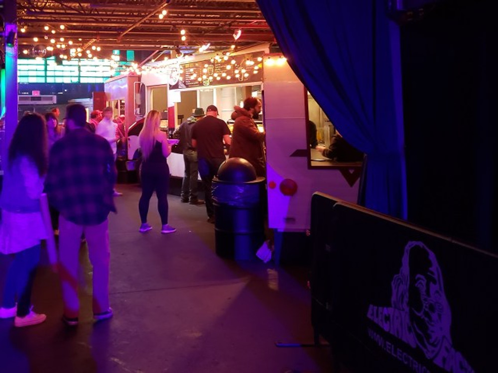 Food trucks parked inside the Electric Factory.