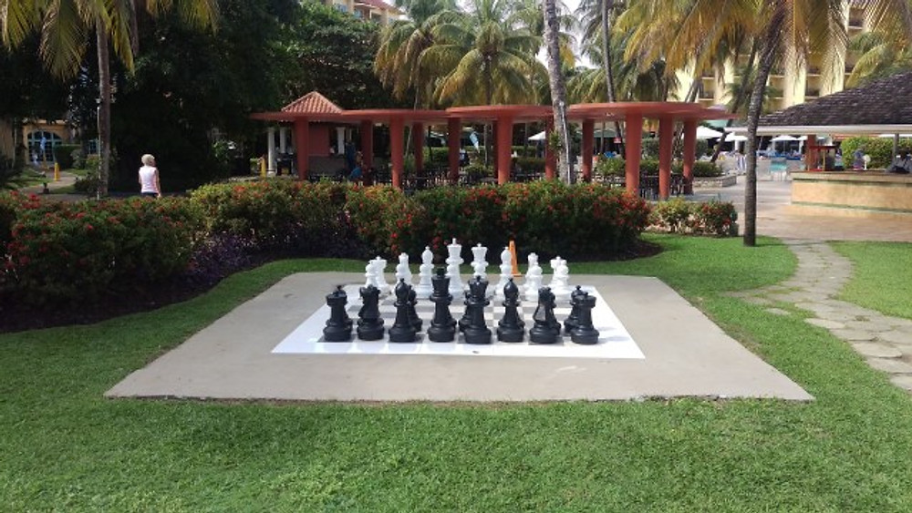 A picture of a giant chess board on the property.