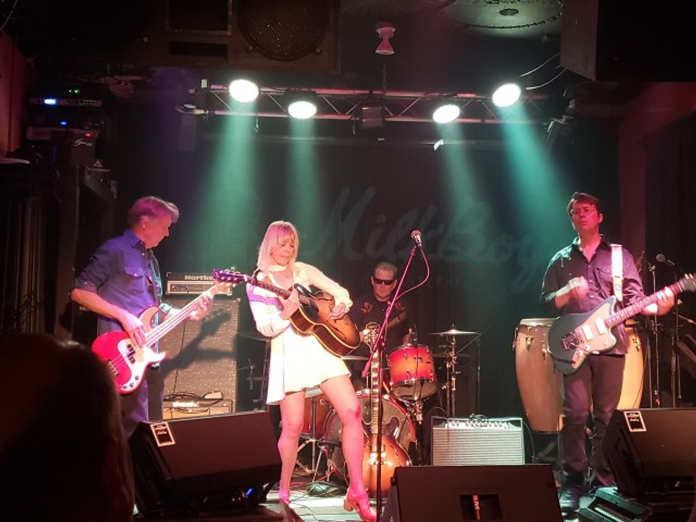 Hayley Thompson-King and her band on stage at MilkBoy in Philly