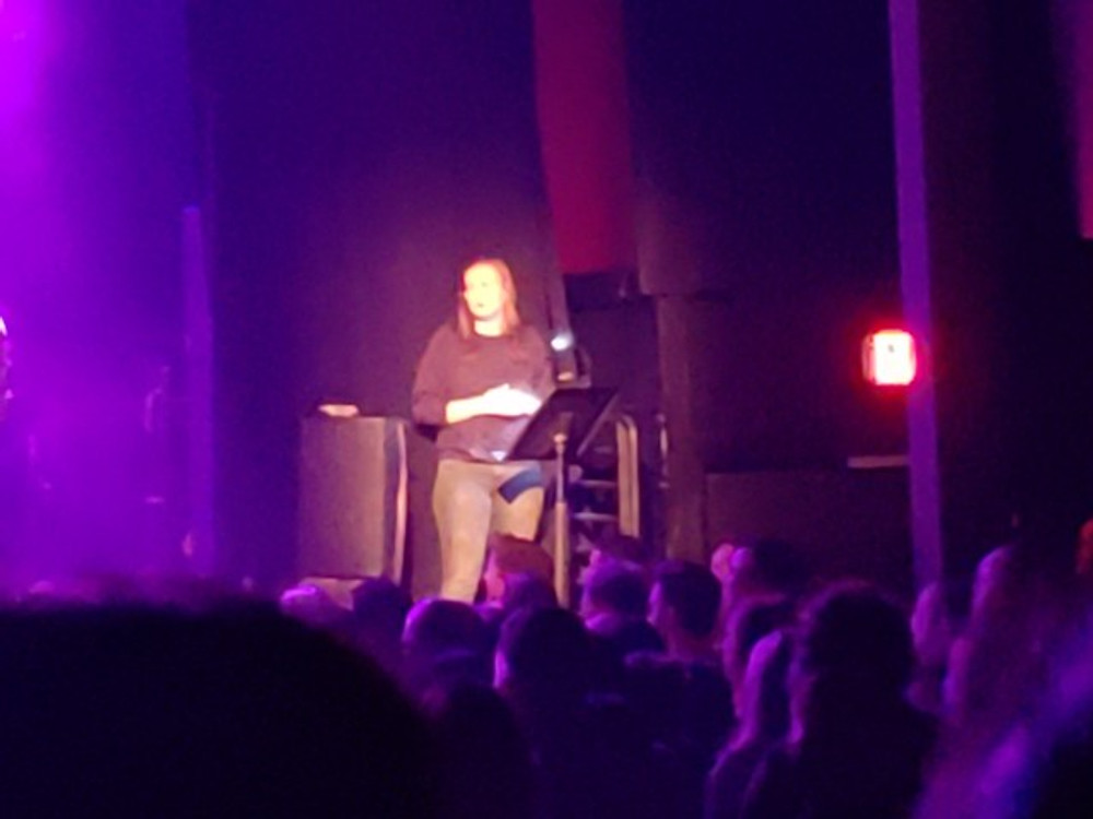 A sign language interpreter on stage at Union Transfer.