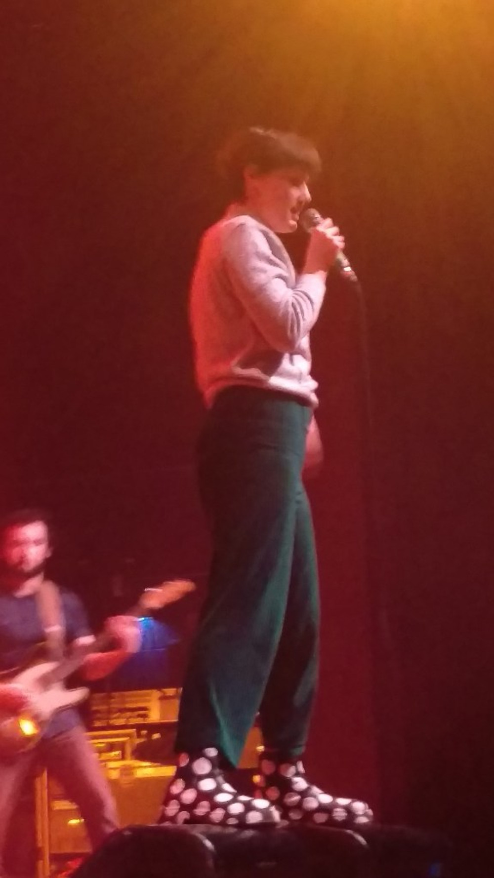 Lead singer Kalmia Traver wearing polka dot rain boots.