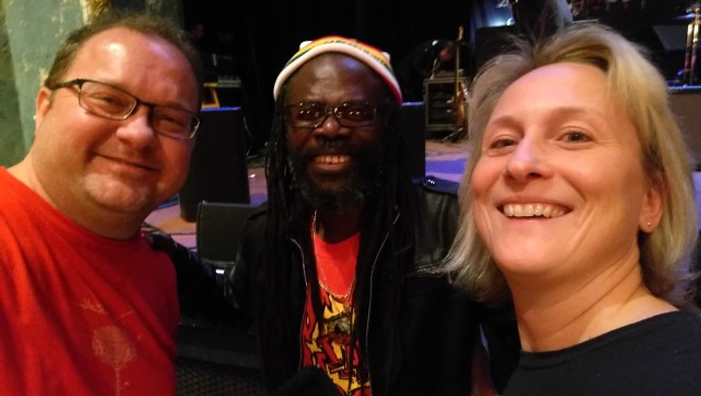 A selfie of my husband and I with Dreadie Reid from The Wailers.