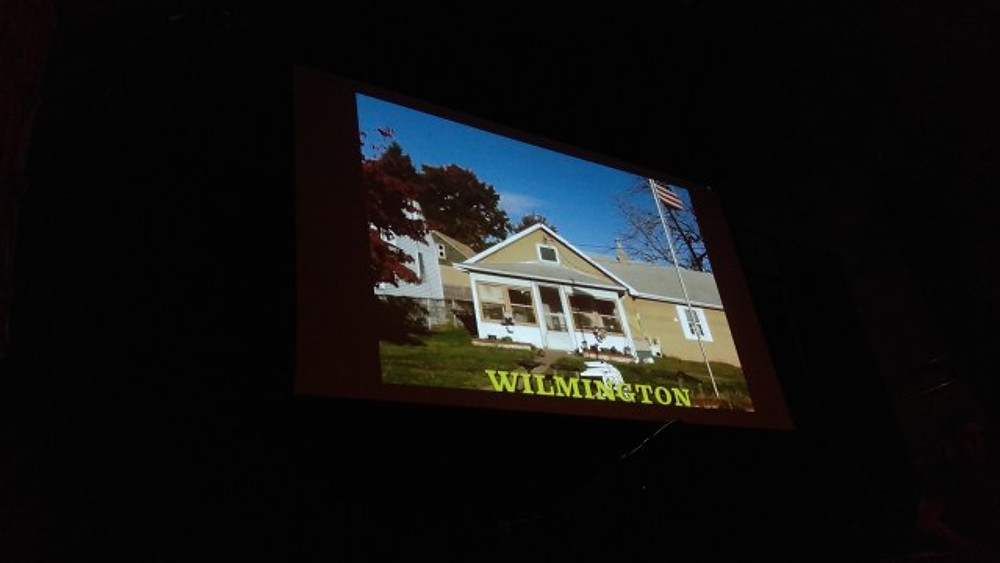 A picture of a small house with the words Wilmington across it.