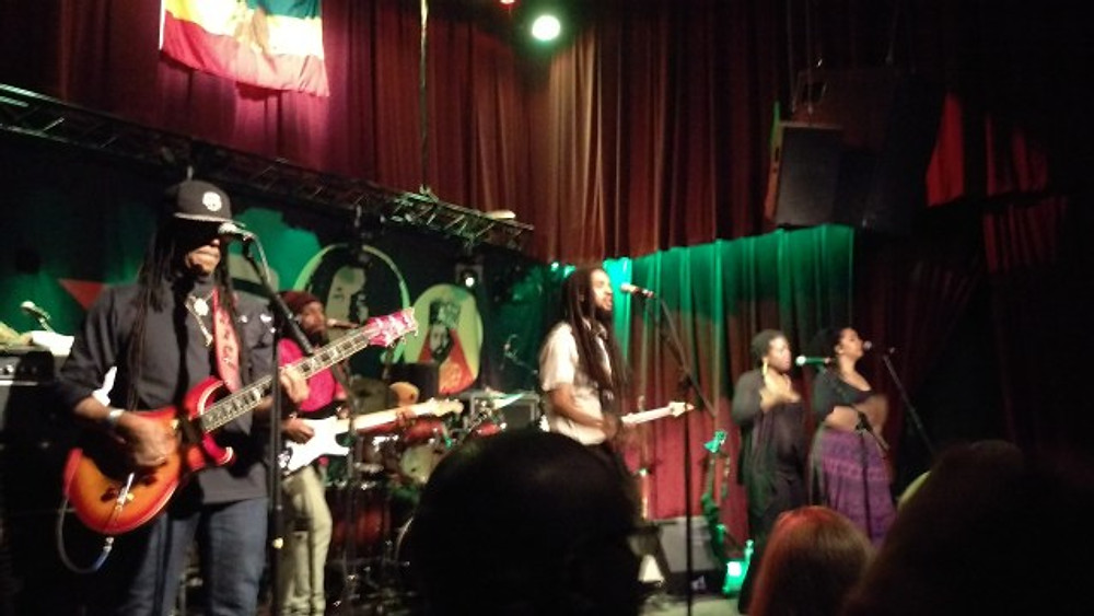 A picture of The Wailers performing at the Ardmore Music Hall.