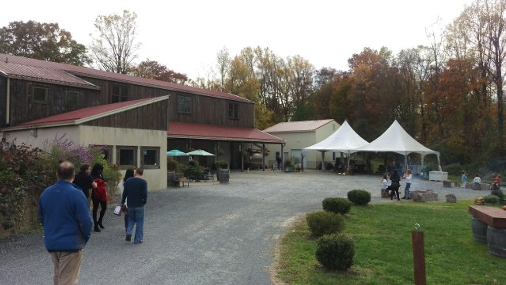 A picture of the tasting room with some tents in the background.