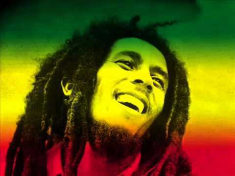A picture of Bob Marley with the Jamaican flag colors.