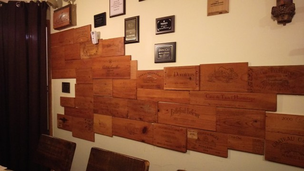 A picture of a number of wooden signs with names of wineries engraved on them.