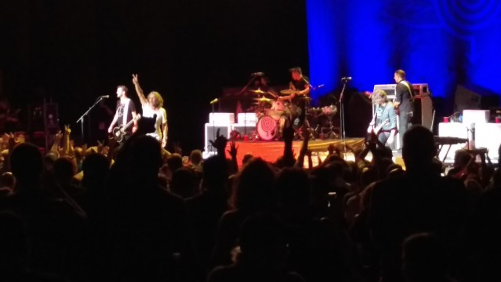 This is a picture of Collective Soul on the stage at The Mann Center.