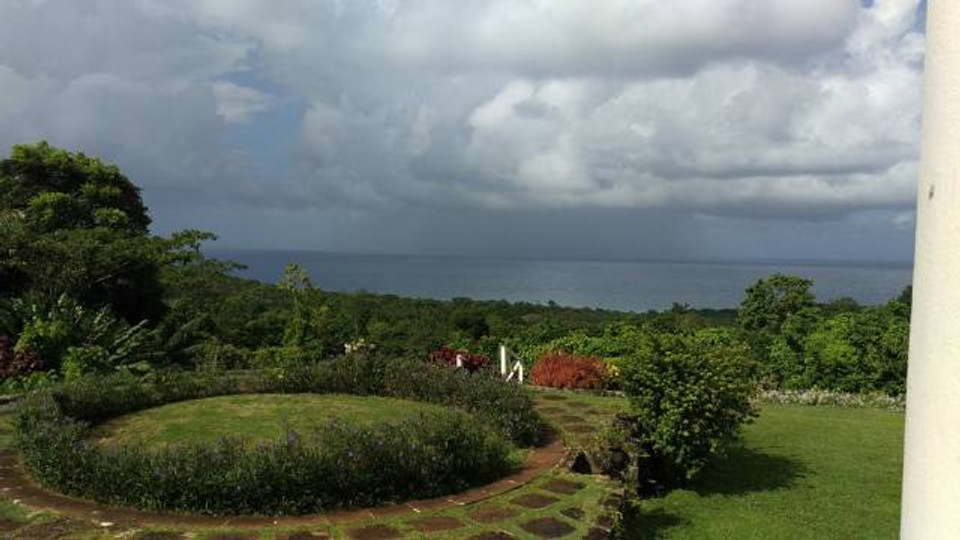 A view of the ocean and the gardens at the plantation house for the Jamaican cooking class.