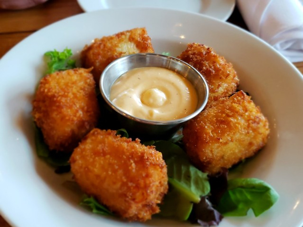 A plate of fried mac and cheese bites at Roy Pitz Barrel House.
