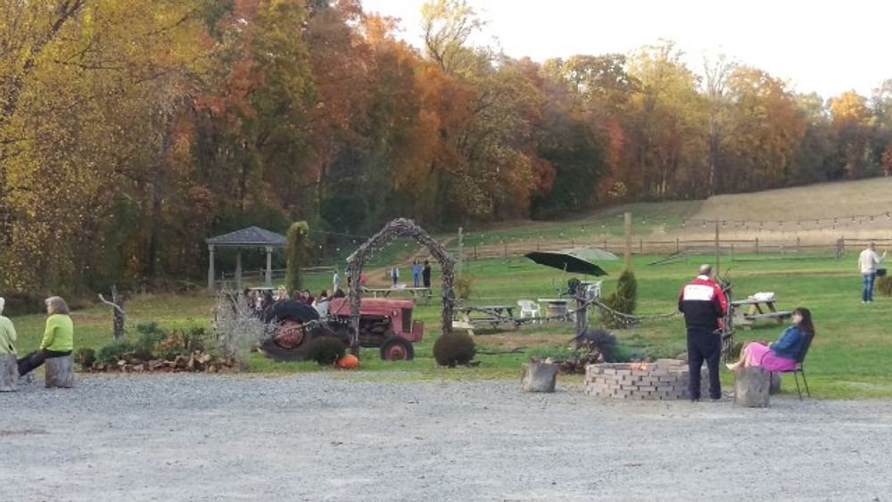 A picture showing the various seating areas, a tractor, and game area.