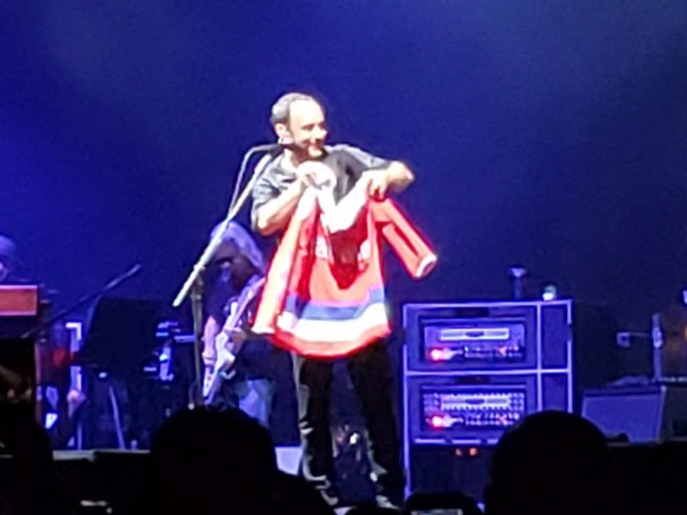 Dave Matthews with a Caps jersey.
