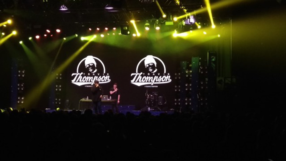 A picture of rapper Travis Thompson on the stage with his DJ.