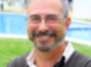 Happy-man-with-glasses-on-lawn[1].jpg